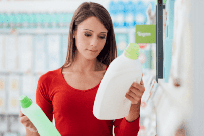 Cleaning Bottle Secrets Revealed Woman Looking at Laundry Bottle