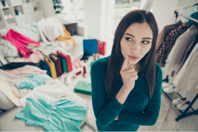 Declutter Your Closet, Woman Thinking About Clothing Piles