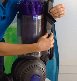 Dyson Animal Ball Vacuum Product Review, Angela Brown Placing Attachment on Vacuum