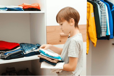 End Cleaning Procrastination, Little Boy Puts Clothes Away