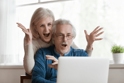 Facebook Lives, Excited Couple Loooking at Computer