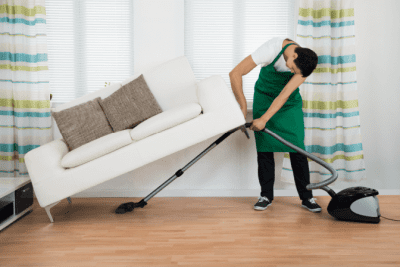 House Cleaner Health, Man Vacuuming Under Couch