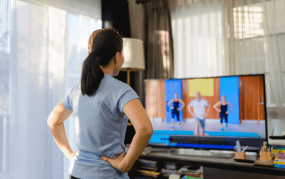 House Cleaner Health, Woman Working Out to Video