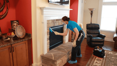 How to Clean a Gas Fireplace, Angela Brown Dusting With Brush