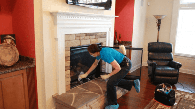 How to Clean a Gas Fireplace, Angela Brown Wiping Glass
