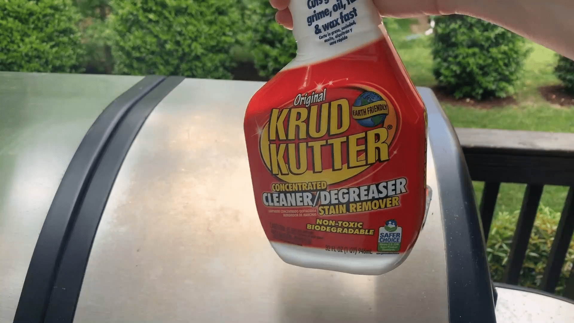 Krud Kutter Product Review, Angela Brown Holding Krud Kutter in Front of Grill