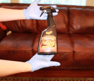 Meguiars Gold Class Leather Conditioner, Gloved Hands Holding Meguiars