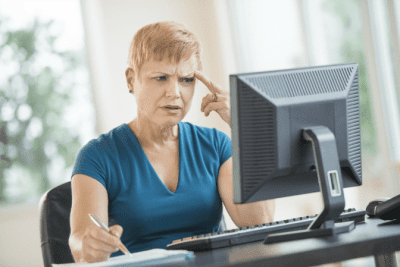 Password Vault for House Cleaners, Confused Woman at Computer