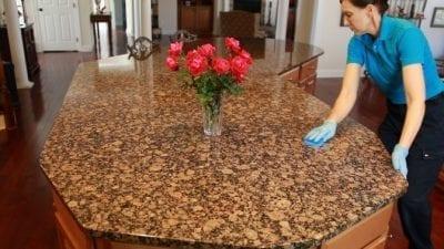 Scotch Brite Non-Scratch Scrub Sponge Wiping down Granite Countertop