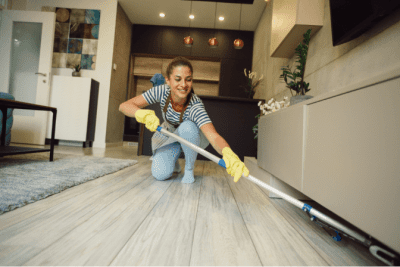 Spin Mop vs. Steam Mop for Hardwood Floors Women Mopping Under Furniture