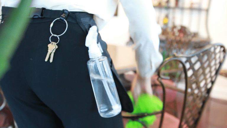 Supply Maid Apron holds spray bottles in side belt loops